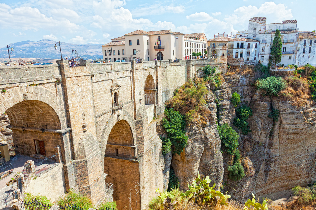 Bridge and houses on the edge of an abyss in the city Rhonda, Spain