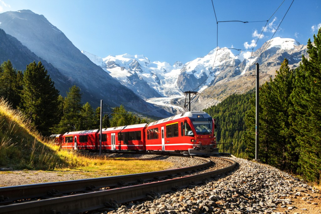 Swiss train in the Alps mountains in Switzerland
