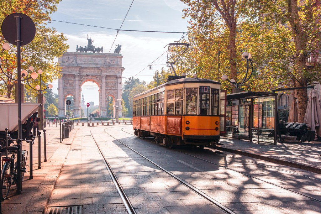 Famous vintage tram in the centre of the Old Town of Milan in the sunny day.