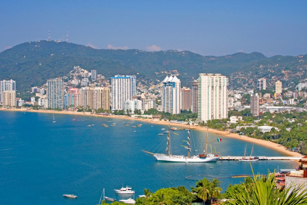 Acapulco beachfront showing the hotels front, Mexico