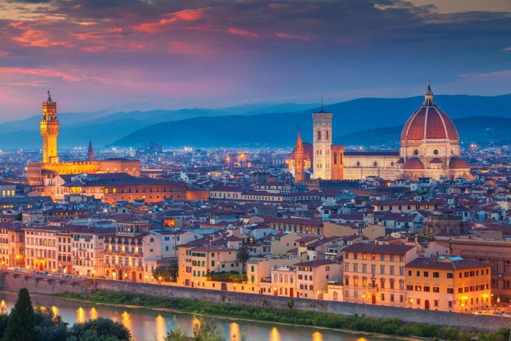 Cityscape image of Florence, Italy during dramatic sunset.