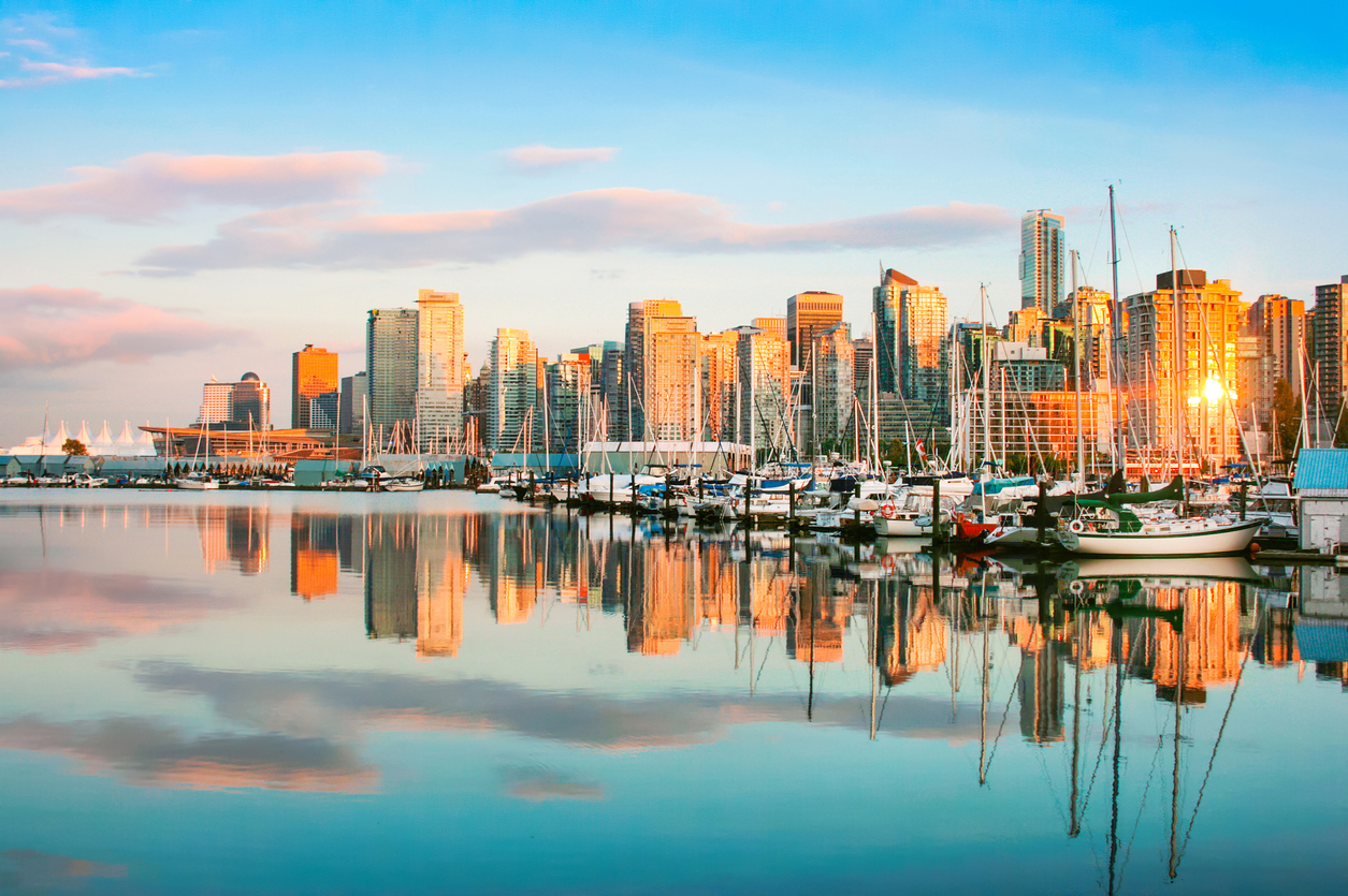 Beautiful view of Vancouver skyline with Stanley Park at sunset, British Columbia, Canada.