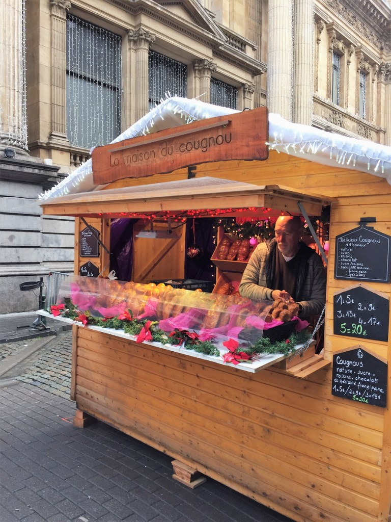 A vendor sells artisan bread of Jesus for Christmas and St. Nicholas Day at the Brussels Christmas market.