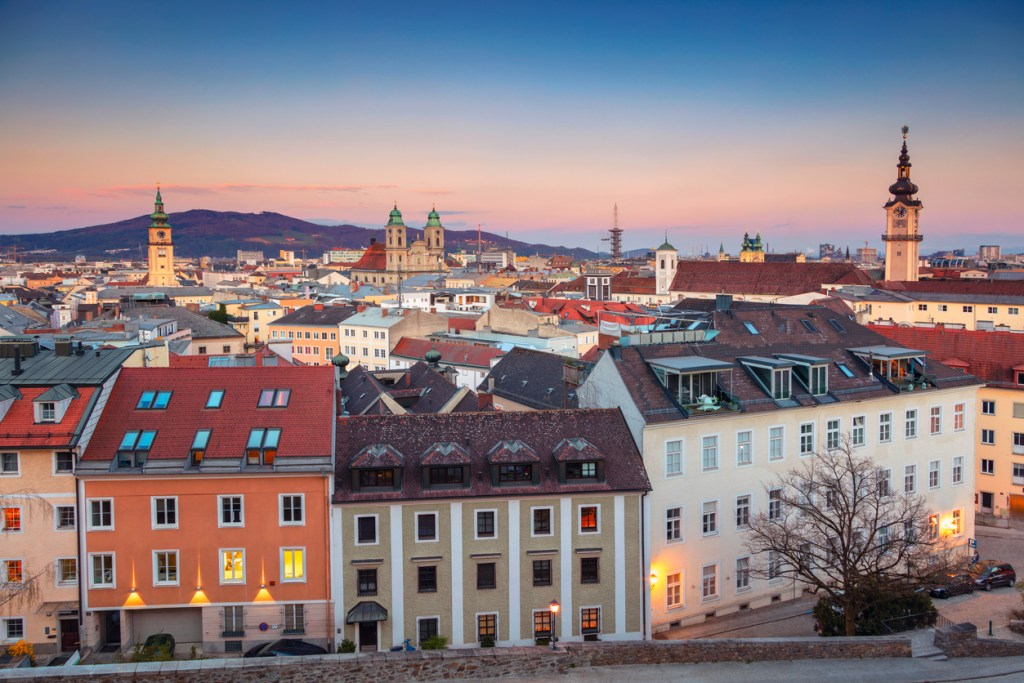 Aerial cityscape image of Linz, Austria during sunset.