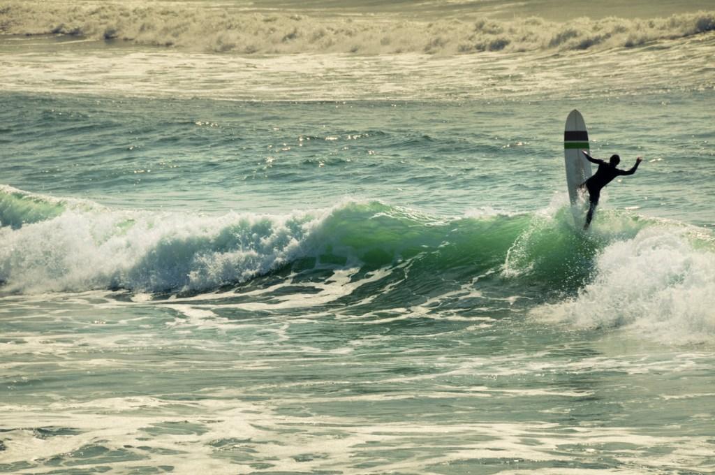 Longboard Surfer having fun in France