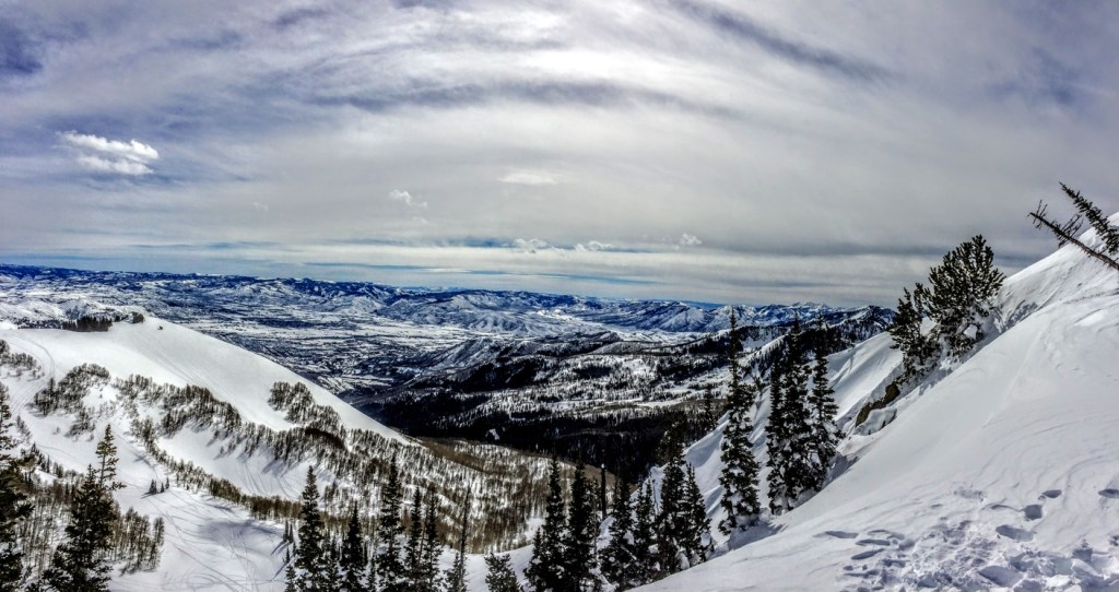 Winter Panoramic view of the back of the Wasatch Mountains Utah from the top of Brighton Ski Resort in the Rocky Mountains