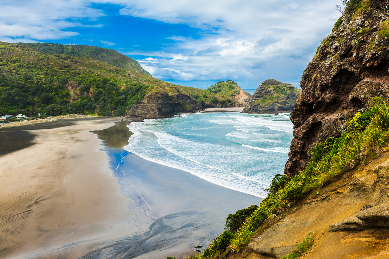 Beautiful Piha beach near Auckland seen from the mighty Lion Rock, New Zealand