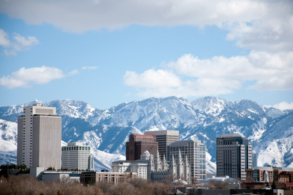 Salt Lake City Utah Winter Skyline With Snow Covered Mountains