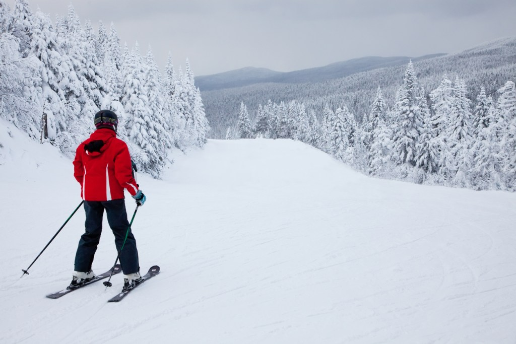 A lonely skier is sliding down an easy slope at Mont-Tremblant.