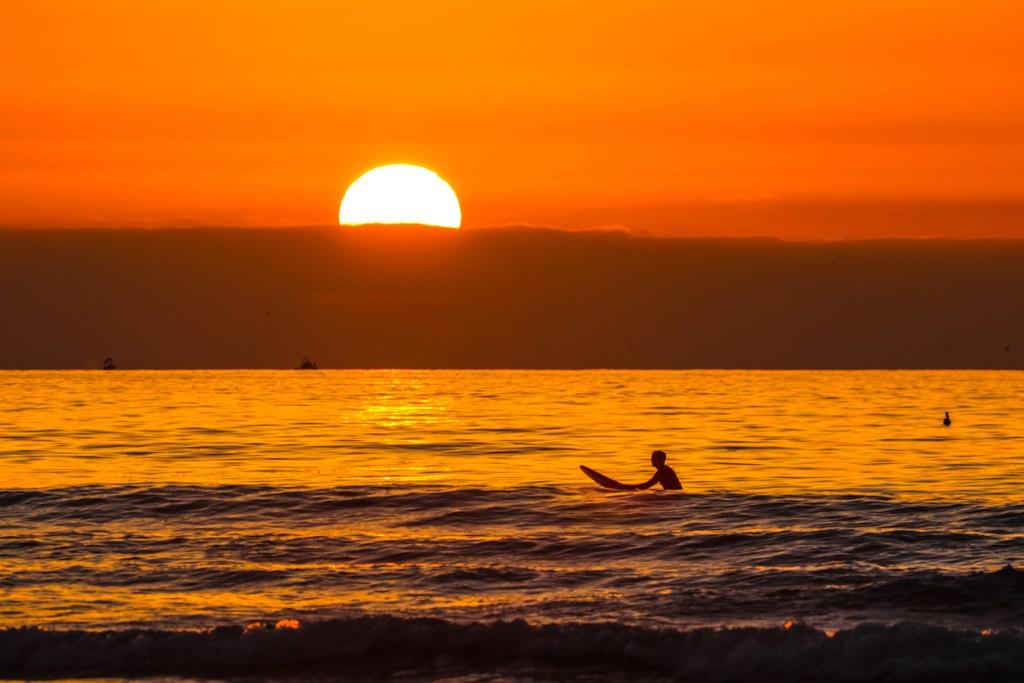 Londboard Surfer at Sunset at La Jolla