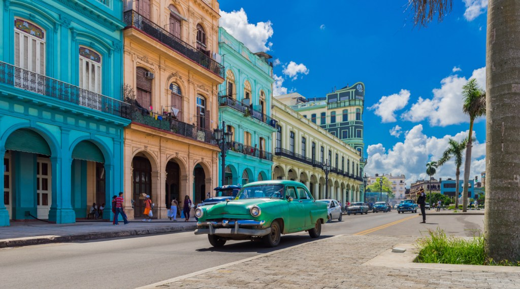 American green vintage car on the main street in Havana City, Cuba