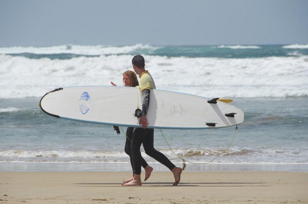 Two surfers walking in Lanzarote