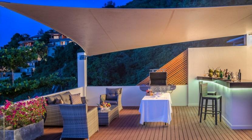 Villa Solaris - Poolside BBQ and bar area at night