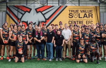 Essendon players support Purple Bombers