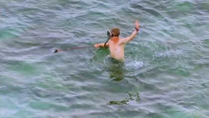 Cambodia- Spencer catches a tiny fish