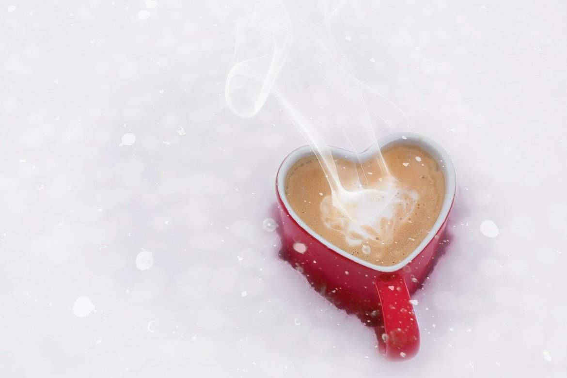 a red heart shape mug filled with coffee, steam coming out and stilling in snow, Valentine's day, purposeful habits