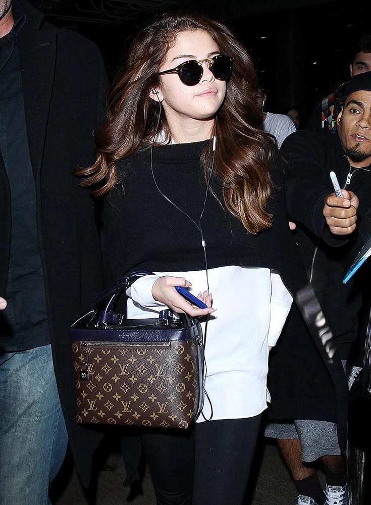 Celebrities That Love Louis Vuitton Handbags - psychside.com