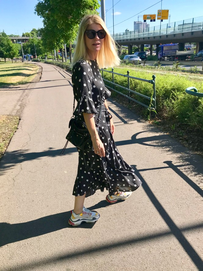 Polka dot dress and Balenciaga Triple S. The feminine dress and dad sneakers.