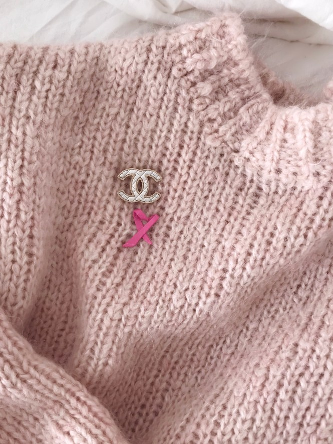 I'm 39 years young, I'm a mom and I have breast cancer. Chanel brooch and pink ribbon.