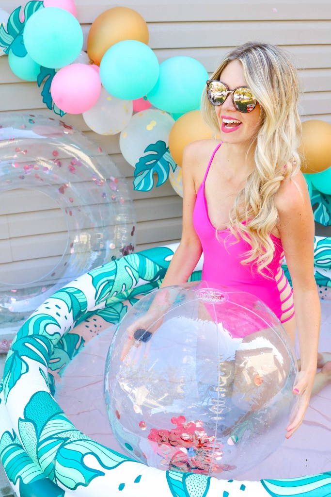 Throw a Minnidip Pool Party with an adult sized inflatable banana leaf pool, floaties, coolers, beach balls and balloon arch! Summer party ideas!