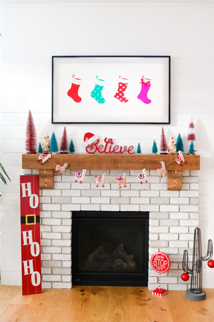 Red pink and teal Christmas fireplace and mantle decorations from Michaels and Walmart. Colourful Christmas decor!