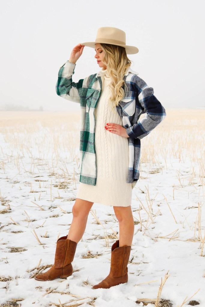 Yellowstone fashion inspiration - cowgirl chic - cream turtleneck dress, plaid shacket, cowboy boots, felt fedora - cowboy outfit ideas