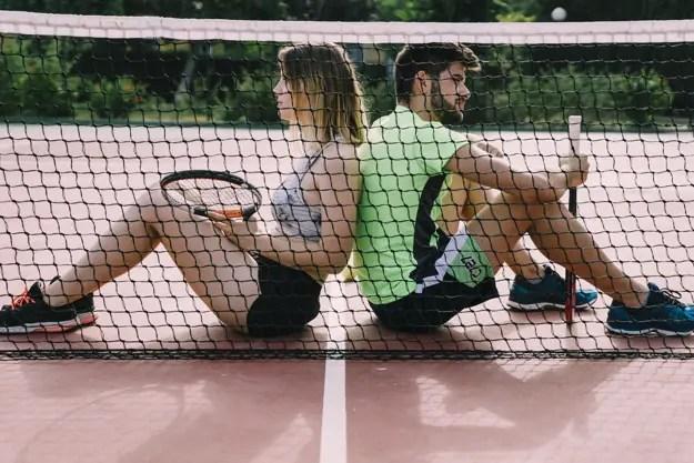 tennis elbow players taking a break by the net