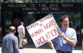 Man with anti-forced treatment sign