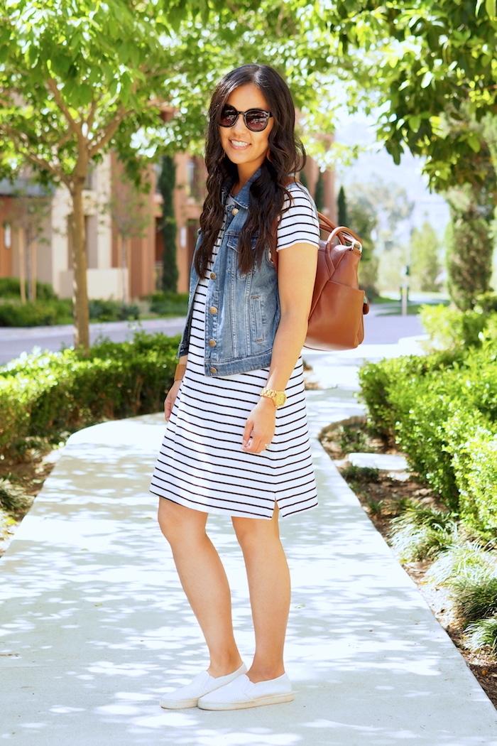 striped dress + denim vest + white sneakers + tan bag