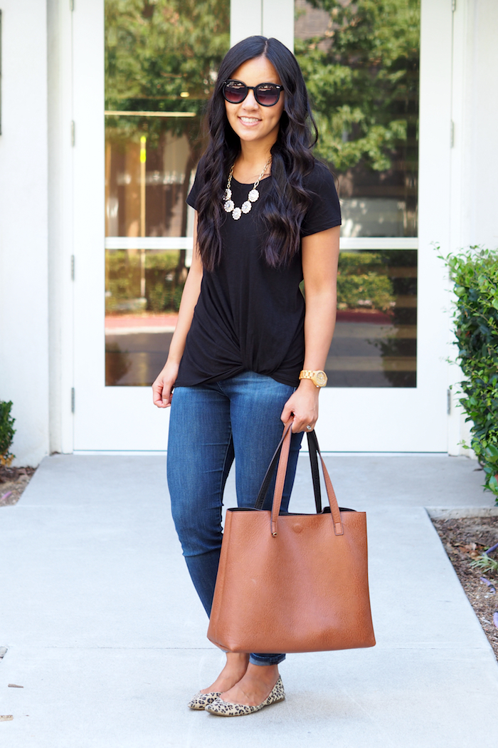 black twist tee + dark wash jeans + statement necklace + leopard flats