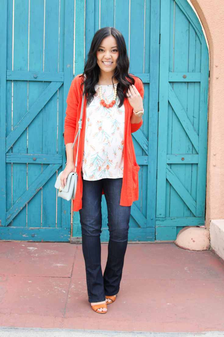 Orange Cardigan + White Blouse + Statement Necklace + Bootcut jeans + Wedges + Mint Purse