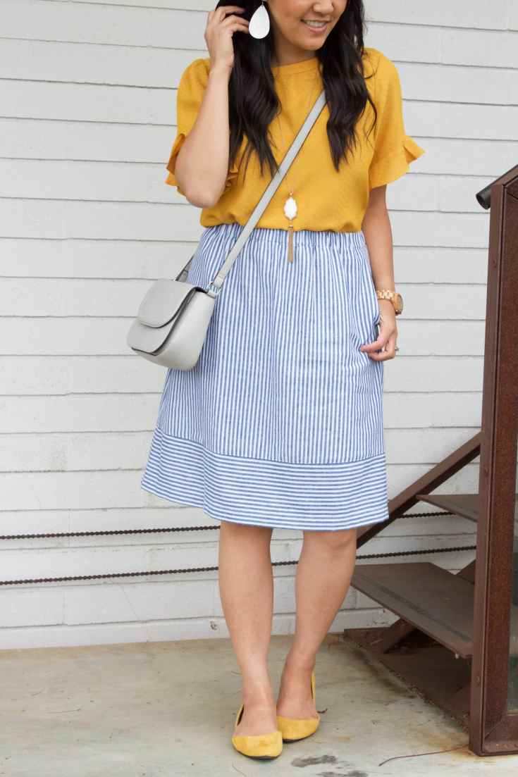 Blue Skirt + Yellow Blouse + White Statement Necklace + Earrings + Flats