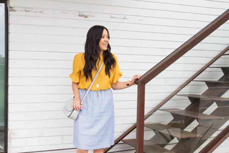 Marigold Top + Striped Skirt + Gray Bag + Statement Necklace