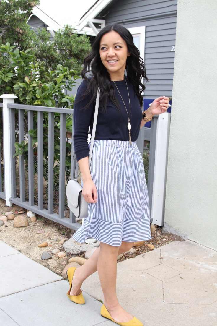 Navy Sweater + Striped Skirt + gray bag + yellow flats