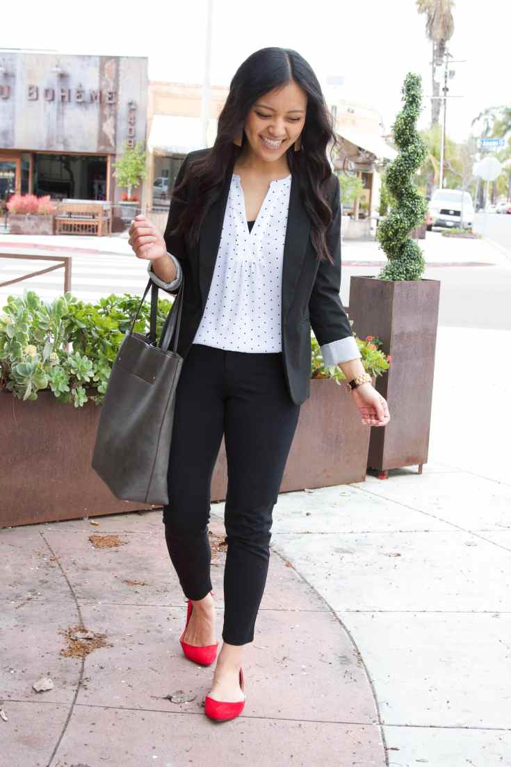 black suit + white polka dot blouse + red flats + grey tote