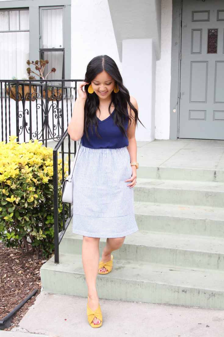 Striped skirt + blue navy top +yellow accessories