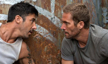 Pecs appeal:  David Belle and Paul Walker in Brick Mansions.