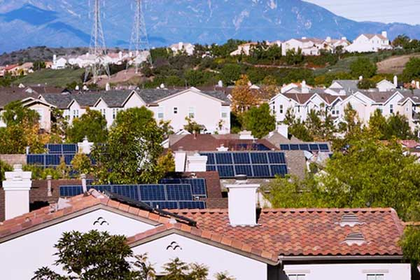 Rooftop view of houses with solar panels