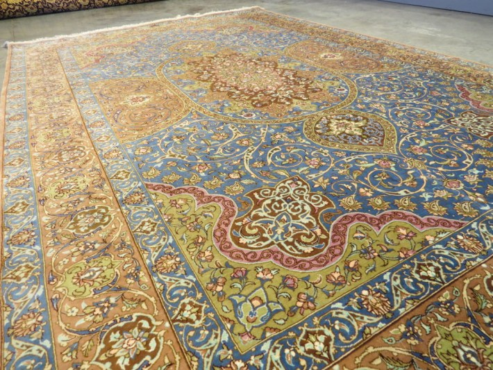 Picture of Persian Silk Rug at a corner view.