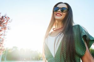 woman smiling in the sunshine