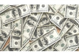 The term used to describe money that flows into a country to take advantage of high rates of interest is called?