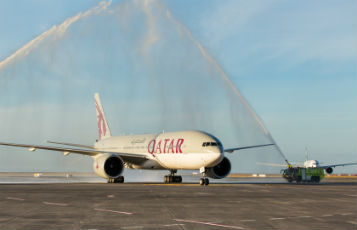 Auckland Airport welcomes the first Qatar Airways flight with a traditional water cannon salute.
