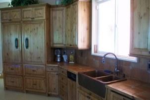 The kitchen boasts custom cabinets, Viking stove and Sub-Zero refrigerator