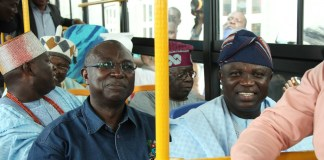 Lagos State Governor, Akinwunmi Ambode (right); Commissioner for Transportation, Dr. Dayo Mobereola (left); APC National Leader, Asiwaju Bola Tinubu (right, behind) and some traditional rulers, during the commissioning of Mile 12-Ikorodu BRT extension and launching of 434 new BRT buses in Ikorodu on Thursday, November 12, 2015.