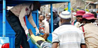 Federal Road Safety Corps (FRSC) officials evacuating a road accident victim