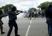 Xenophobia South African police fire rubber bullets during protest