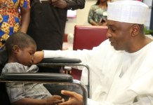 Bukola Saraki and young Boko Haram victim Ali Ahmadu