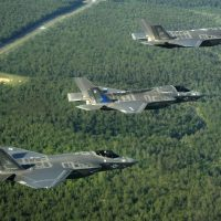 F-35_Lightning_II_variants_in_flight_near_Eglin_AFB_in_2014