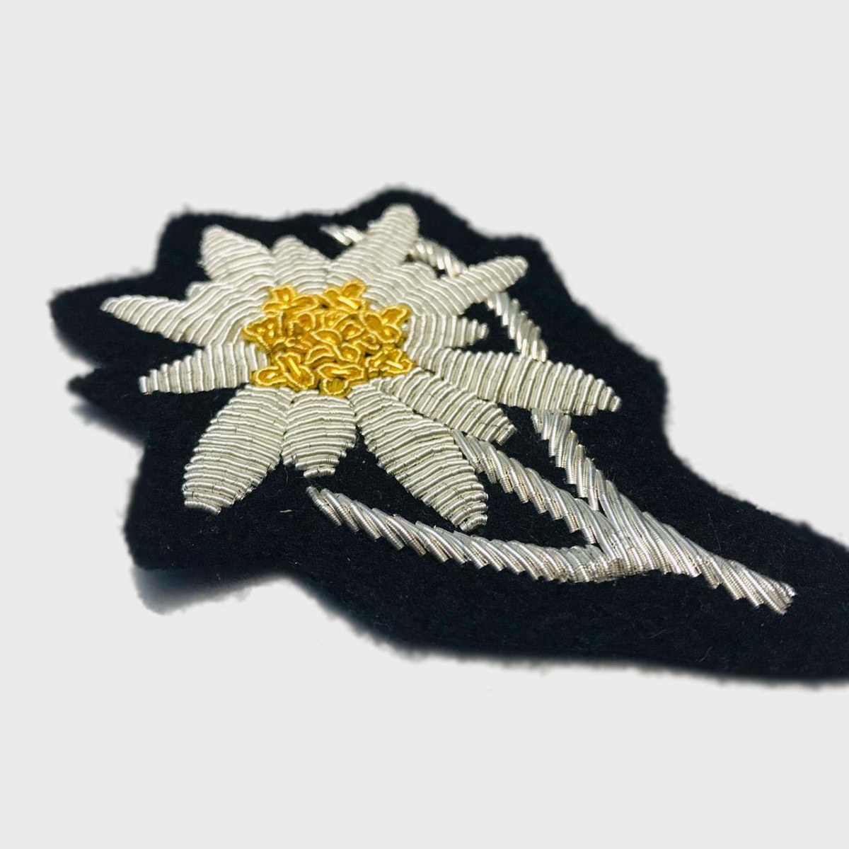Edelweiss Flower Bullion Embroidered Badge , Sew-on Applique Patch - Edelweiss EmbroideredPatch Size # 3inches Sew-on backing Silverbullion wires embroidered on felt  3
