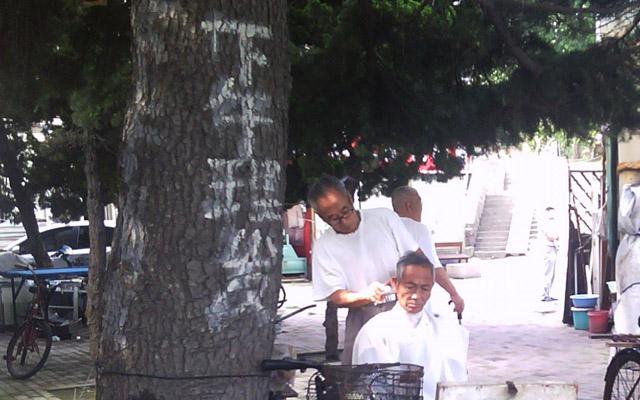 Roadside Barber Qingdao, China